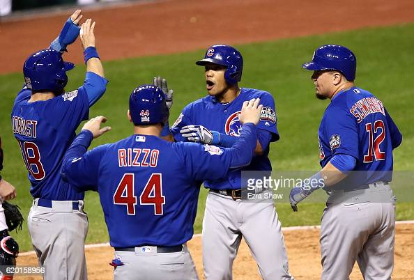 Addison Russell of the Chicago Cubs celebrates with Anthony Rizzo Ben Zobrist and Kyle Schwarber after hitting a grand slam home run during the third...