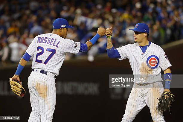 Addison Russell of the Chicago Cubs celebrates with Javier Baez after defeating the Los Angeles Dodgers 84 in game one of the National League...