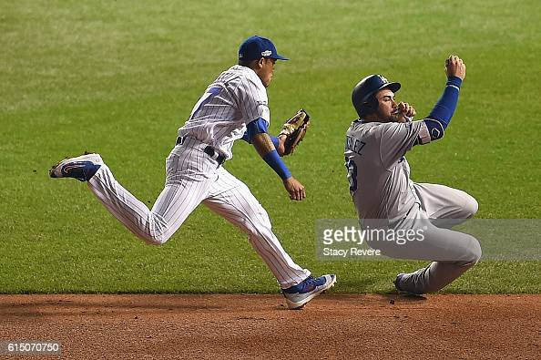 Addison Russell of the Chicago Cubs chases Adrian Gonzalez of the Los Angeles Dodgers in the sixth inning before tagging him out to complete the...