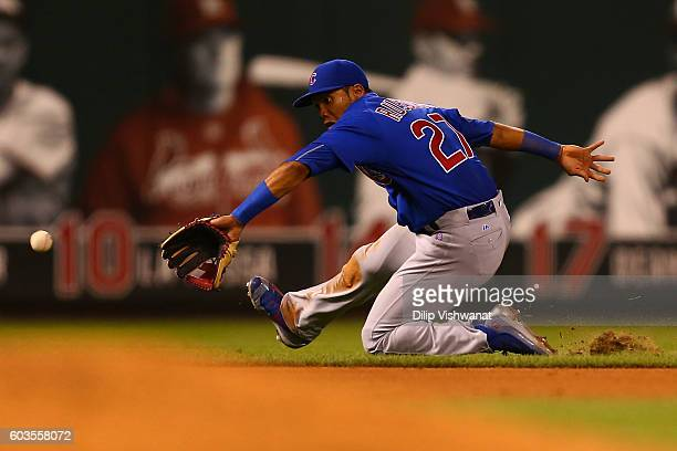 Addison Russell of the Chicago Cubs fields the ball against the St Louis Cardinals in the sixth inning at Busch Stadium on September 12 2016 in St...