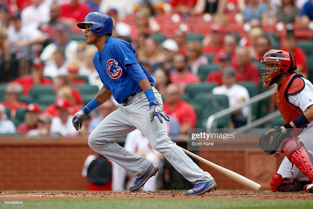 <a gi-track='captionPersonalityLinkClicked' href=/galleries/search?phrase=Addison+Russell&family=editorial&specificpeople=9513105 ng-click='$event.stopPropagation()'>Addison Russell</a> #27 of the Chicago Cubs follows through on a RBI single during the second inning against the St. Louis Cardinals at Busch Stadium on May 25, 2016 in St. Louis, Missouri.