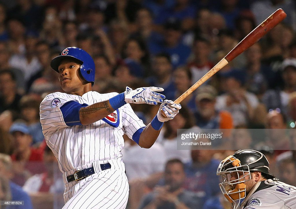 Addison Russell #22 of the Chicago Cubs hits a run-scoring double in the 4th inning against the Colorado Rockies at Wrigley Field on July 27, 2015 in Chicago, Illinois.