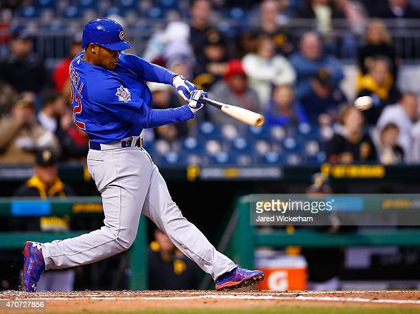 Addison Russell of the Chicago Cubs hits a single in the third inning his first major league hit against the Pittsburgh Pirates during the game at...