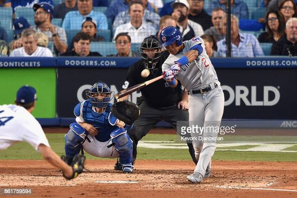 Addison Russell of the Chicago Cubs hits a solo home run in the fifth inning against the Los Angeles Dodgers during game two of the National League...