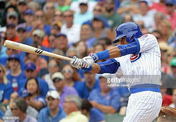Addison Russell of the Chicago Cubs hits a two run double in the 1st inning against the New York Mets at Wrigley Field on July 20 2016 in Chicago...