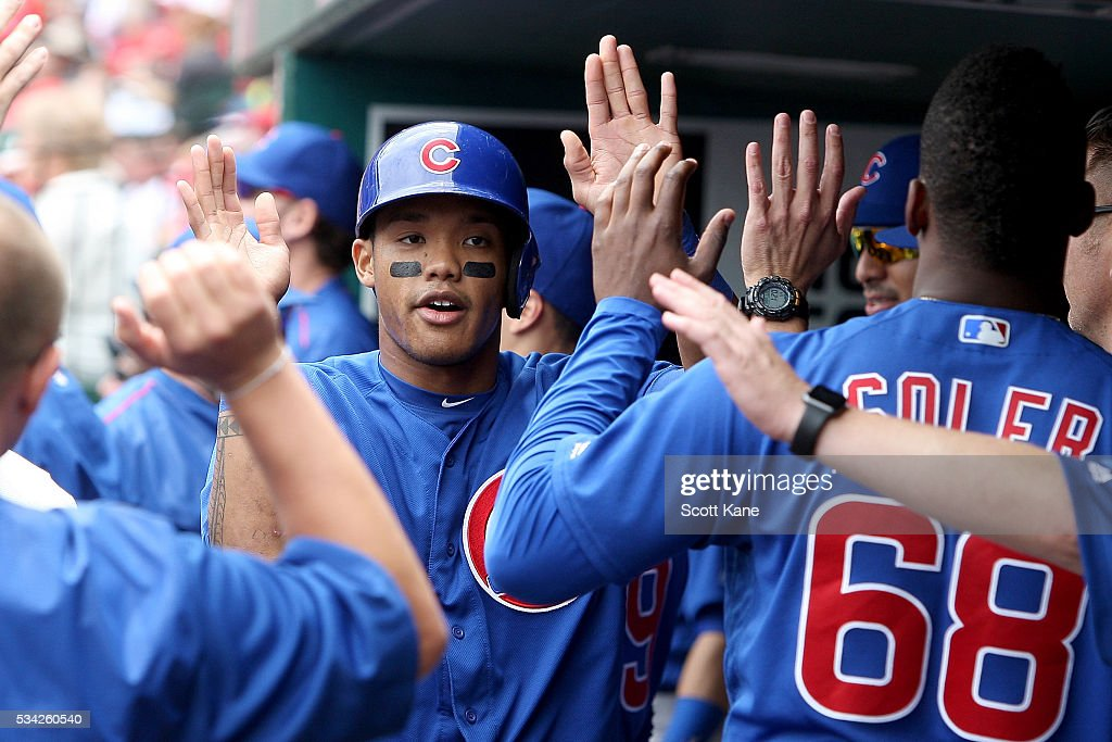 <a gi-track='captionPersonalityLinkClicked' href=/galleries/search?phrase=Addison+Russell&family=editorial&specificpeople=9513105 ng-click='$event.stopPropagation()'>Addison Russell</a> #27 of the Chicago Cubs is congratulate by teammates after scoring a run during the second inning against the St. Louis Cardinals at Busch Stadium on May 25, 2016 in St. Louis, Missouri.