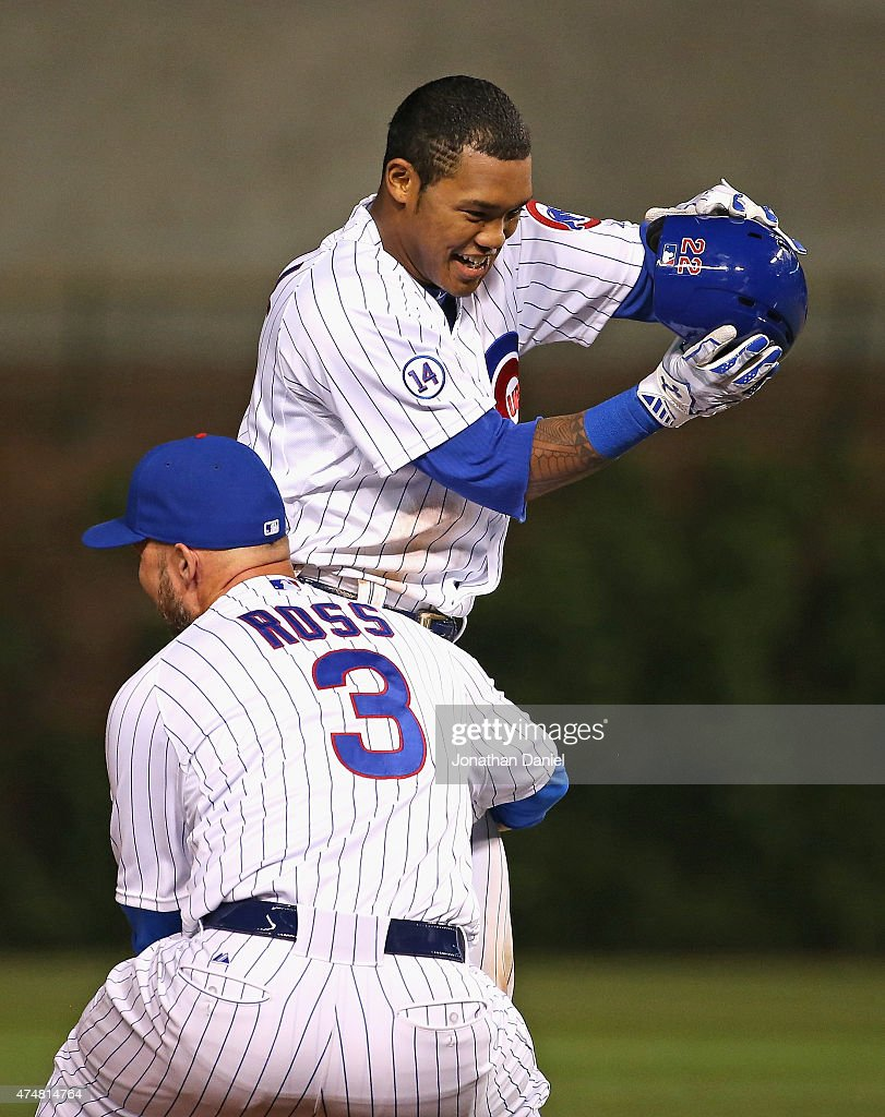 Addison Russell #22 of the Chicago Cubs is lifted by David Ross #3 after getting the game-winning hit, a double off of the center field wall, in the bottom of the 9th inning against the Washington Nationals at Wrigley Field on May 26, 2015 in Chicago, Illinois. The Cubs defeated the Nationals 3-2.