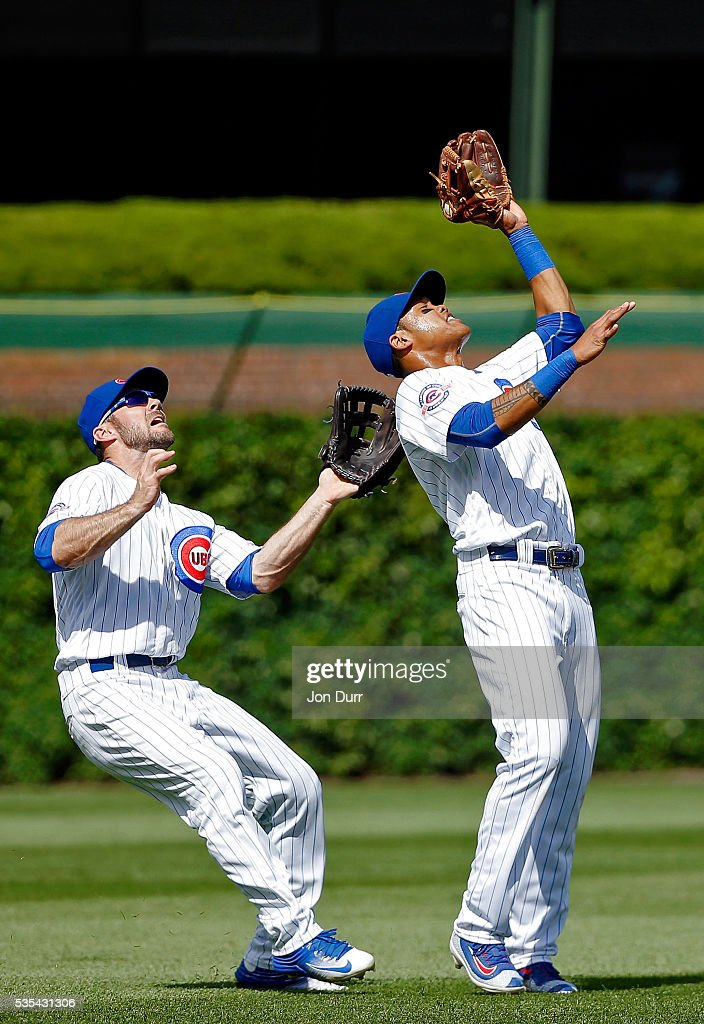 <a gi-track='captionPersonalityLinkClicked' href=/galleries/search?phrase=Addison+Russell&family=editorial&specificpeople=9513105 ng-click='$event.stopPropagation()'>Addison Russell</a> #27 of the Chicago Cubs (R) makes a catch for an out against the Philadelphia Phillies during the eighth inning as Matt Szczur #20 almost collides with him at Wrigley Field on May 29, 2016 in Chicago, Illinois.