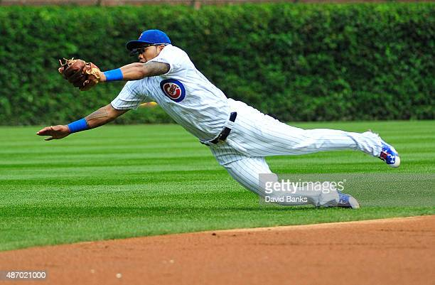 Addison Russell of the Chicago Cubs makes a diving catch on AJ Pollock of the Arizona Diamondbacks during the third inning on September 5 2015 at...