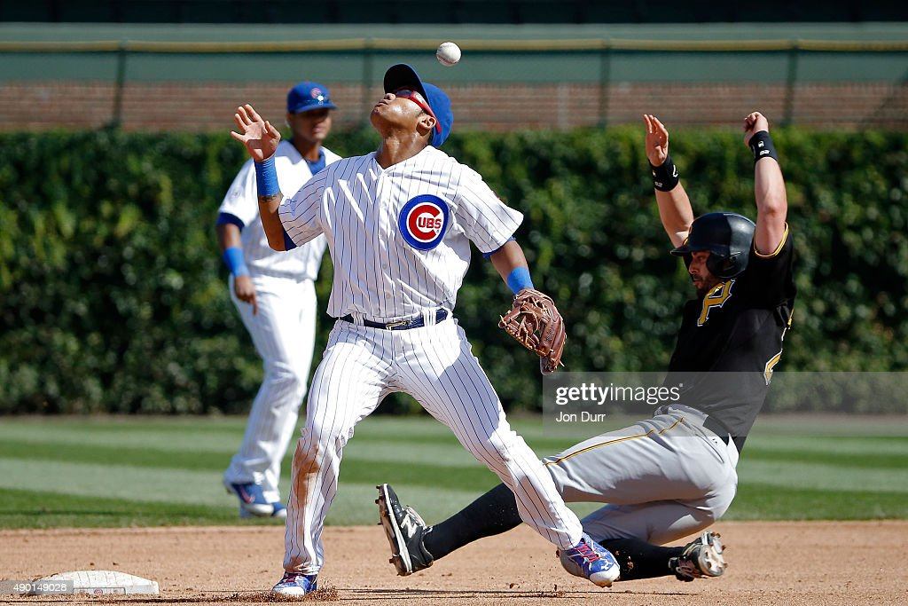 Addison Russell #22 of the Chicago Cubs mishandles the ball after forcing out Pedro Alvarez #24 of the Pittsburgh Pirates at second base during the sixth inning at Wrigley Field on September 26, 2015 in Chicago, Illinois.