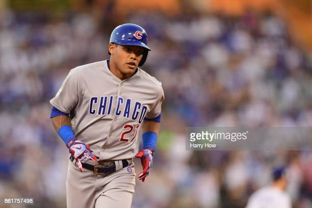 Addison Russell of the Chicago Cubs runs the bases after hitting a solo home run in the fifth inning against the Los Angeles Dodgers during game two...