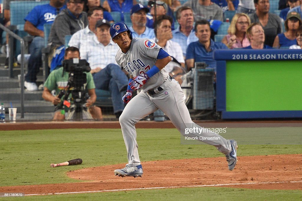 Addison Russell #27 of the Chicago Cubs runs the bases after hitting a solo home run in the fifth inning against the Los Angeles Dodgers during game two of the National League Championship Series at Dodger Stadium on October 15, 2017 in Los Angeles, California.