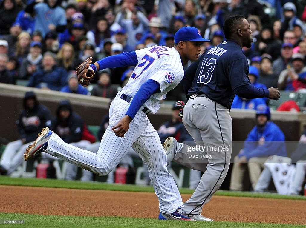 Addison Russell #27 of the Chicago Cubs tags out Adonis Garcia #13 of the Atlanta Braves during the sixth inning on May 1, 2016 at Wrigley Field in Chicago, Illinois.