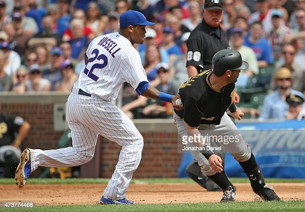 Addison Russell of the Chicago Cubs tags out Neil Walker of the Pittsburgh Pirates on a rundown in the 5th inning at Wrigley Field on May 17 2015 in...