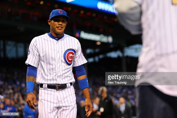 Addison Russell of the Chicago Cubs takes the field during the World Series ring ceremony ahead of the game between the Los Angeles Dodgers and the...