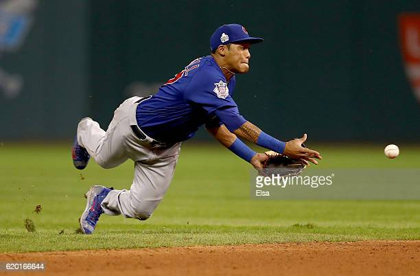Addison Russell of the Chicago Cubs throws the ball to Javier Baez to force out Lonnie Chisenhall of the Cleveland Indians at second base during the...