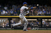 Addison Russell of the Chicago Cubs throws to first base in the sixth inning against the Milwaukee Brewers at Miller Park on July 22 2016 in...