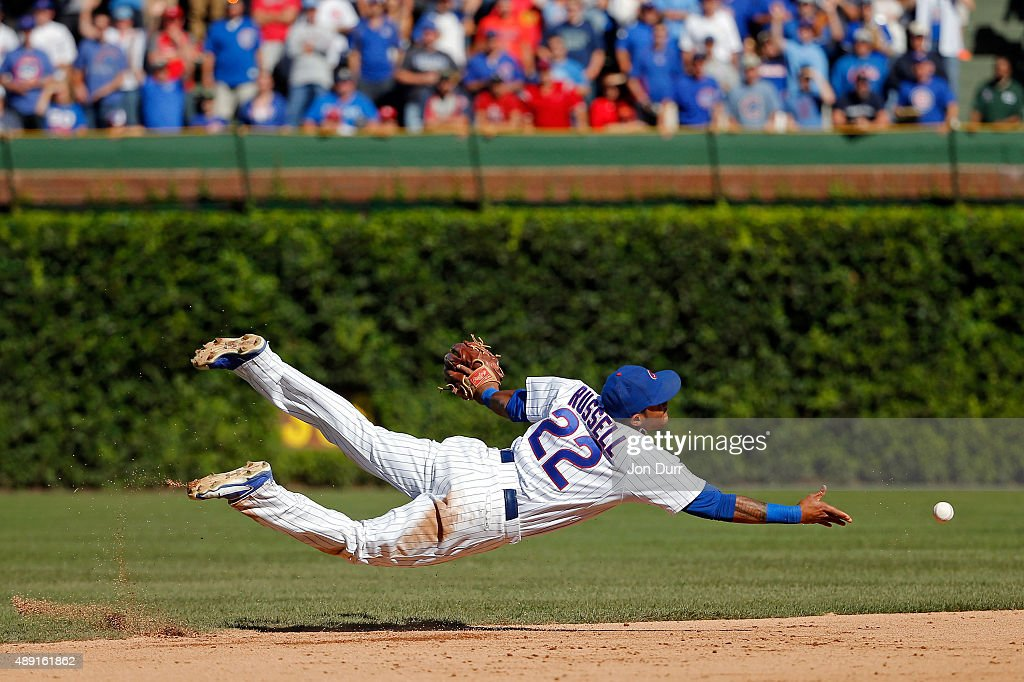 Addison Russell #22 of the Chicago Cubs tosses the ball to Javier Baez (not pictured) for the final out of the game against the St. Louis Cardinals at Wrigley Field on September 19, 2015 in Chicago, Illinois. The Chicago Cubs won 5-4.