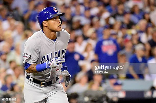 Addison Russell of the Chicago Cubs watches as he hits a tworun home run in the fourth inning against the Los Angeles Dodgers in game four of the...