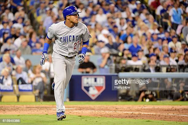 Addison Russell of the Chicago Cubs watches as he hits a tworun home run in the sixth inning against the Los Angeles Dodgers in game five of the...