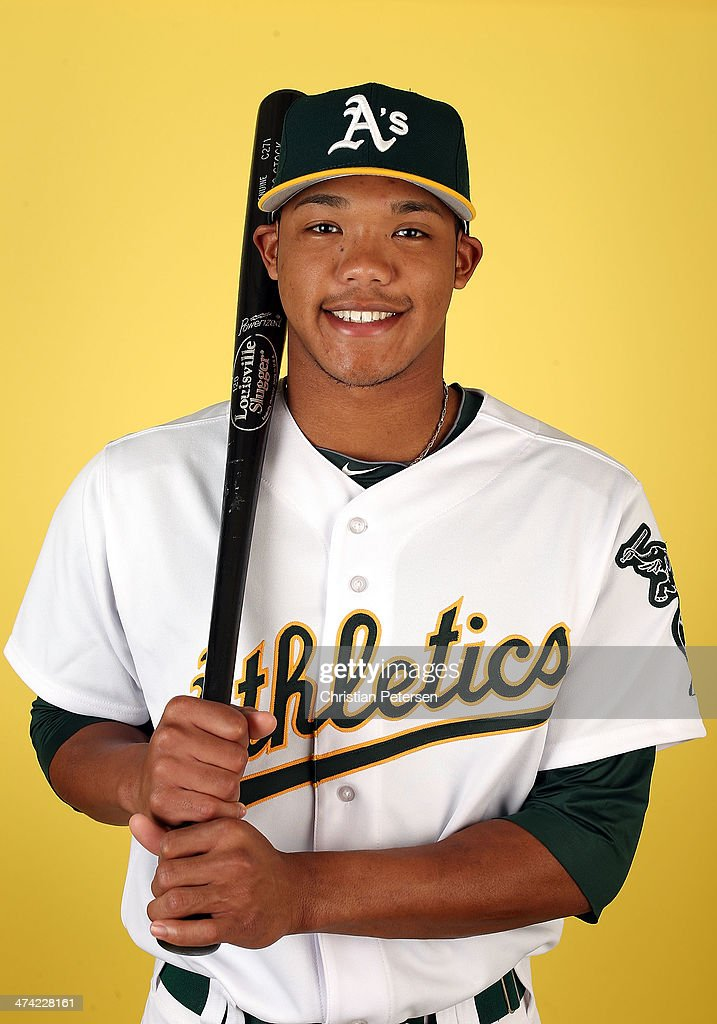 Addison Russell #17 of the Oakland Athletics poses for a portrait during the spring training photo day at Phoenix Municipal Stadium on February 22, 2014 in Phoenix, Arizona.