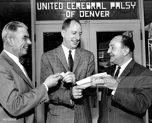MAR 6 1960 MAR 7 1960 Addition to Palsy Center Opened Contractor Gerald H Phipps does a bit of fancy handwork to accept his check for the new $60000...