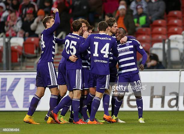 Addy Waku Menga of Osnabrueck jubilates with team mates after scoring the second goal during the third league match between FC Energie Cottbus and...