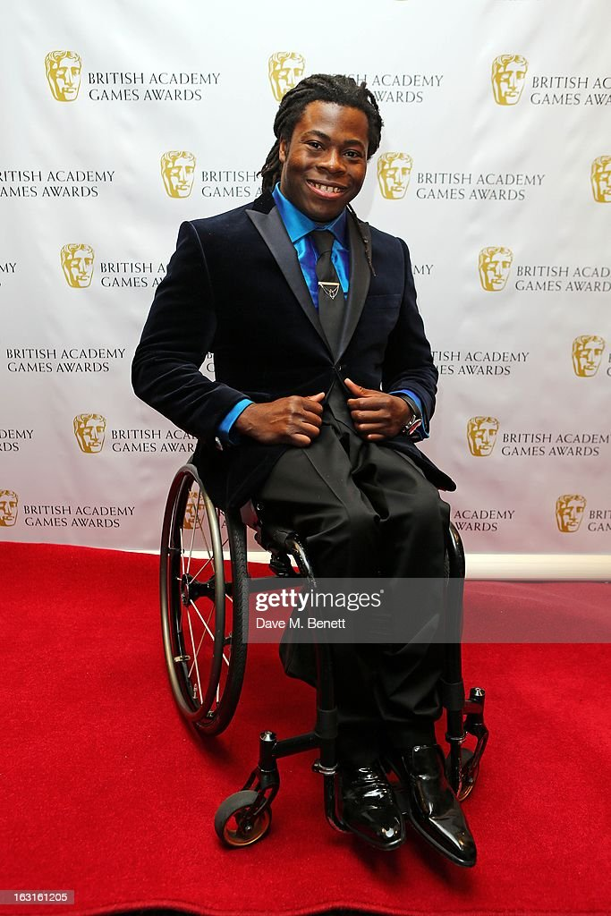 <a gi-track='captionPersonalityLinkClicked' href=/galleries/search?phrase=Ade+Adepitan&family=editorial&specificpeople=2323506 ng-click='$event.stopPropagation()'>Ade Adepitan</a> attends The British Academy Games Awards at London Hilton on March 5, 2013 in London, England.