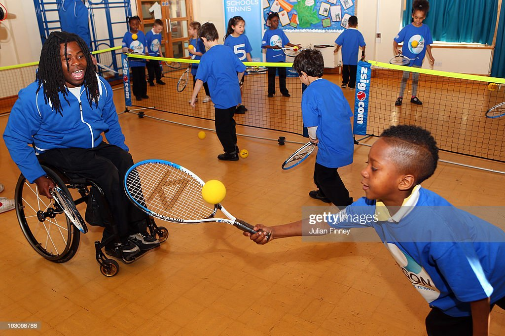 <a gi-track='captionPersonalityLinkClicked' href=/galleries/search?phrase=Ade+Adepitan&family=editorial&specificpeople=2323506 ng-click='$event.stopPropagation()'>Ade Adepitan</a> watches a child play tennis at the Britannia Village Primary School on March 4, 2013 in London, England. Aegon Schools Tennis Programme names Britannia Village Primary School, Newham as the 15,000th School beneficiary today which coincides with World Tennis Day.