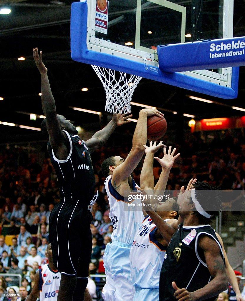 Ade Dagrundo of Mitteldeutscher BC is blocked by Jeff Gibbs of Bremerhaven during the Beko Basketball Bundesliga game between Eisbaeren Bremerhaven...