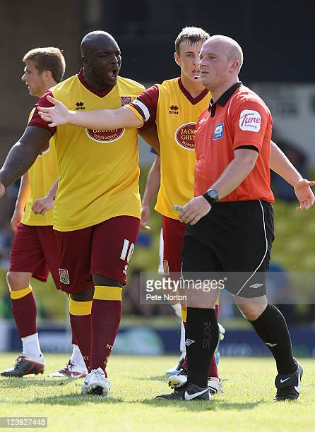 Adebayo Akinfenwa and John Johnson of Northampton Town make a point to referee Simon Hooper during the npower League Two match between Southend...