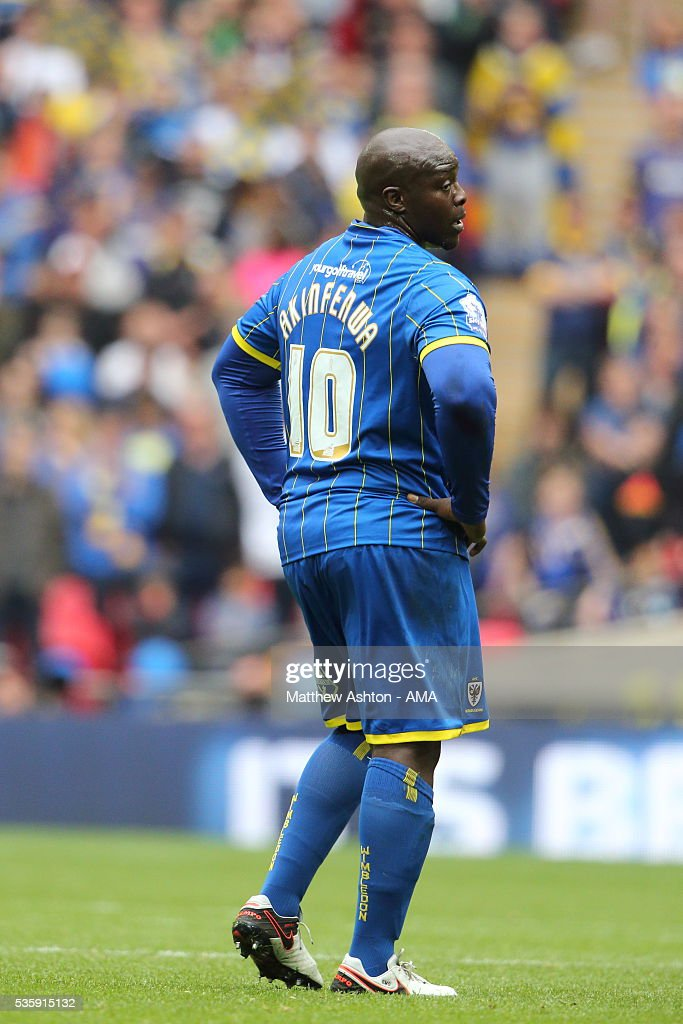 <a gi-track='captionPersonalityLinkClicked' href=/galleries/search?phrase=Adebayo+Akinfenwa&family=editorial&specificpeople=609204 ng-click='$event.stopPropagation()'>Adebayo Akinfenwa</a> of AFC Wimbledon during the Sky Bet League Two Play Off Final between Plymouth Argyle and AFC Wimbledon at Wembley Stadium on May 30, 2016 in London, England.