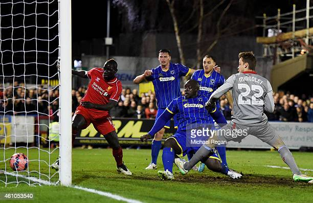 Adebayo Akinfenwa of AFC Wimbledon pokes the ball into the net to score a goal and level the scores at 11 during the FA Cup Third Round match between...