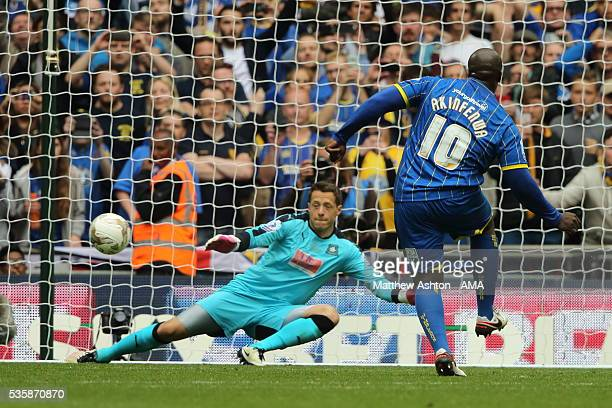 Adebayo Akinfenwa of AFC Wimbledon scores a goal from the penalty spot to make it 20 during the Sky Bet League Two Play Off Final between Plymouth...