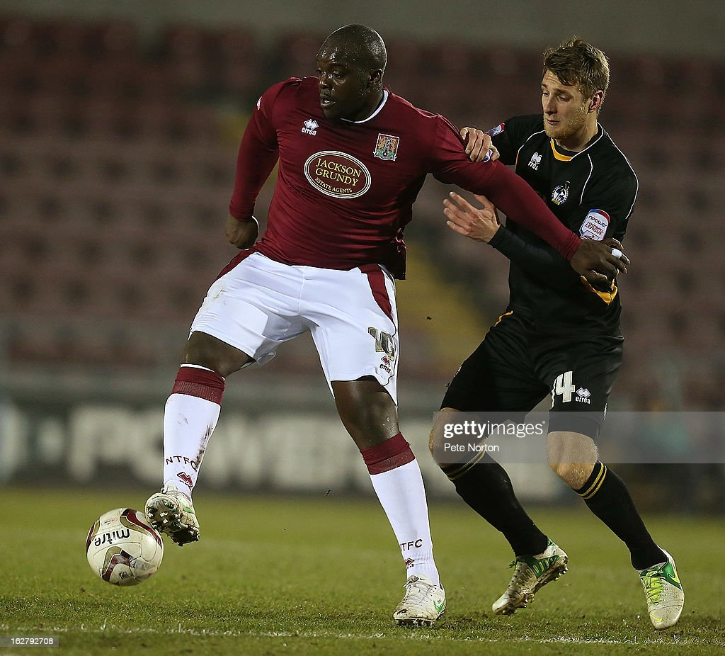 Adebayo Akinfenwa (L) of Northampton Town attempts to control the ball under pressure from Lee Brown of Bristol Rovers during the npower League Two match between Northampton Town and Bristol Rovers at Sixfields Stadium on February 26, 2013 in Northampton, England.