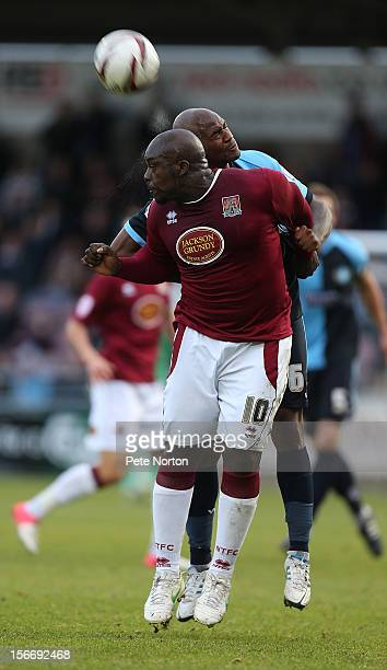 Adebayo Akinfenwa of Northampton Town challenges for the ball with Leon Johnson of Wycombe Wanderers during the npower League Two match between...