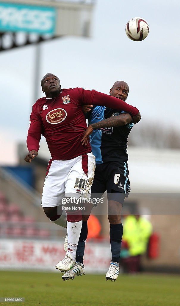 Adebayo Akinfenwa of Northampton Town challenges for the ball with Leon Johnson of Wycombe Wanderers during the npower League Two match between Northampton Town and Wycombe Wanderers at Sixfields Stadium on November 17, 2012 in Northampton, England.