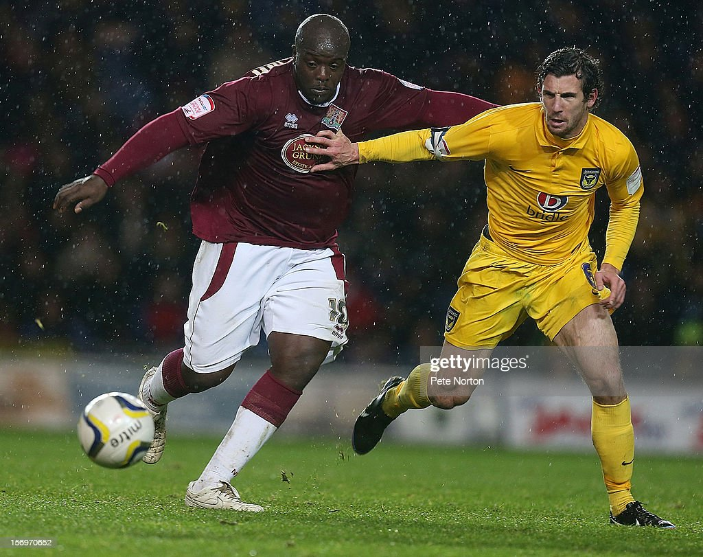 <a gi-track='captionPersonalityLinkClicked' href=/galleries/search?phrase=Adebayo+Akinfenwa&family=editorial&specificpeople=609204 ng-click='$event.stopPropagation()'>Adebayo Akinfenwa</a> of Northampton Town contests the ball with Jake Wright of Oxford United during the npower League Two match between Oxford United and Northampton Town at Kassam Stadium on November 24, 2012 in Oxford, England.