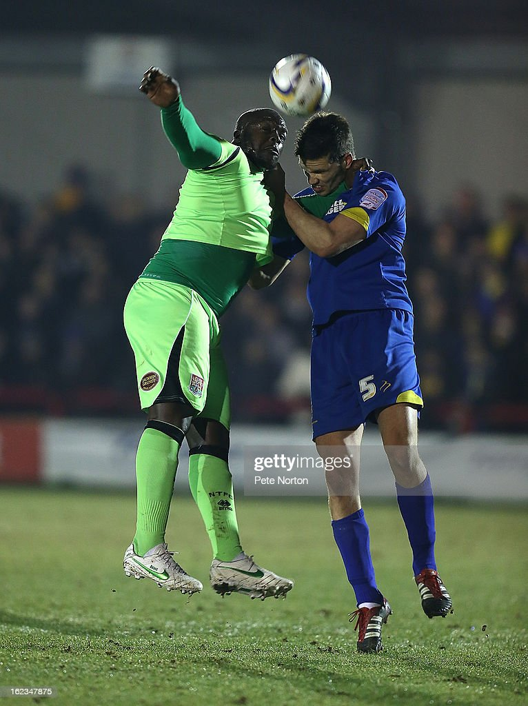 Adebayo Akinfenwa of Northampton Town contests the ball with Pim Balkestein of AFC Wimbledon during the npower League Two match between AFC Wimbledon and Northampton Town at The Cherry Red Records Stadium on February 19, 2013 in Kingston upon Thames, England.