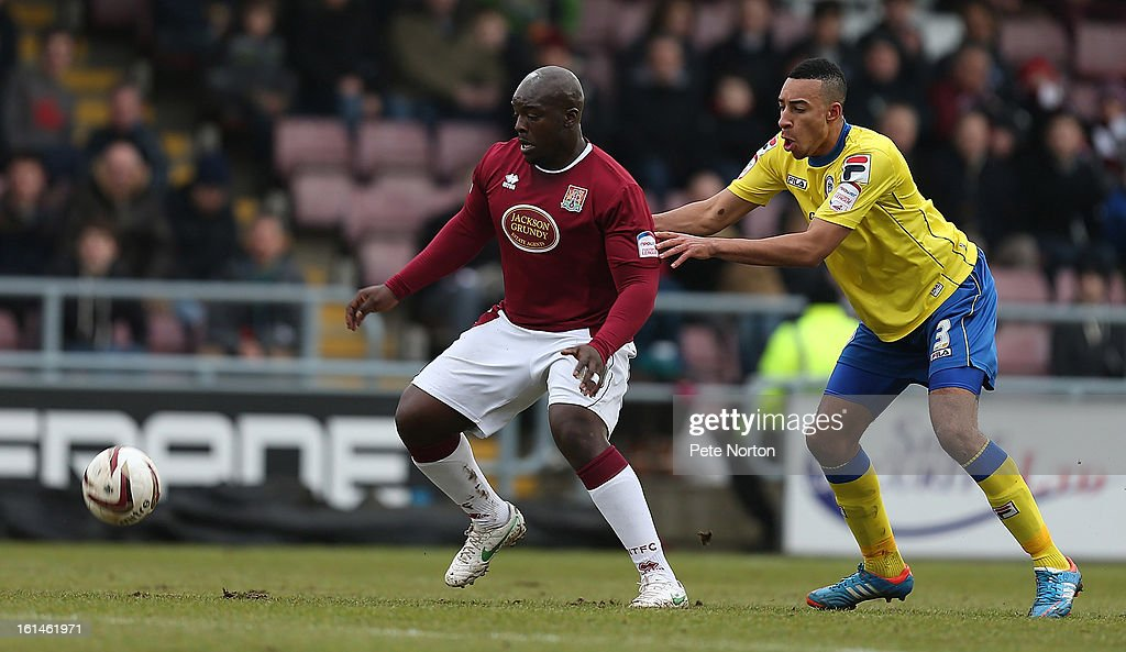 Adebayo Akinfenwa (L) of Northampton Town looks to control the ball under pressure from Rhys Bennett of Rochdale during the npower League Two match between Northampton Town and Rochdale at Sixfields Stadium on February 9, 2013 in Northampton, England.