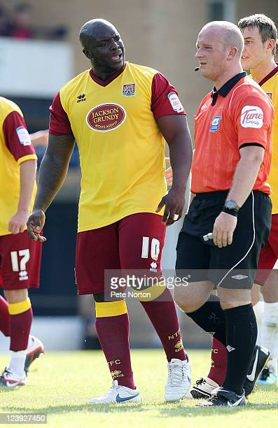 Adebayo Akinfenwa of Northampton Town makes a point to referee Simon Hooper during the npower League Two match between Southend United and...