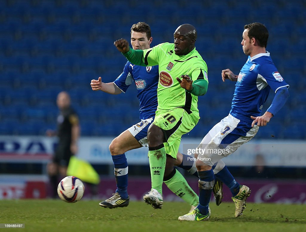 Adebayo Akinfenwa of Northampton Town moves with the ball between Craig Clay and Sam Togwell of Chesterfield during the npower League Two match between Chesterfield and Northampton Town at the Proact Srtadium on January 12, 2013 in Chesterfield, England.