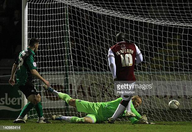 Adebayo Akinfenwa of Northampton Town scores his and his sides second goal during the npower League Two match between Northampton Town and Bristol...