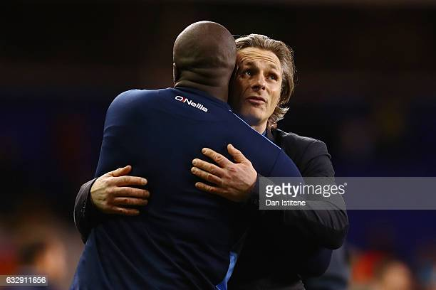 Adebayo Akinfenwa of Wycombe Wandearers and Gareth Ainsworth Manager of Wycombe Wanderers look dejected after the full time whistle during the...
