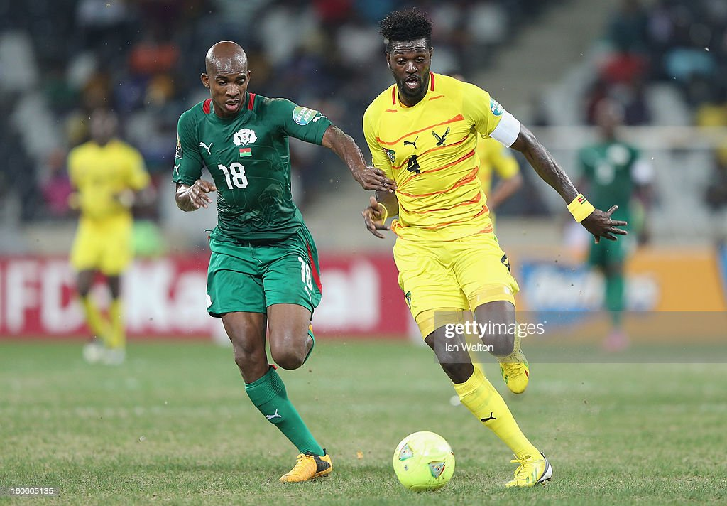 Adebayor Emmanuel Sheyi of Togo is tackled by Kabore Charles of Burkina Faso during the 2013 Africa Cup of Nations Quarter-Final match between Burkina Faso and Togo at the Mbombela Stadium on February 3, 2013 in Nelspruit, South Africa.