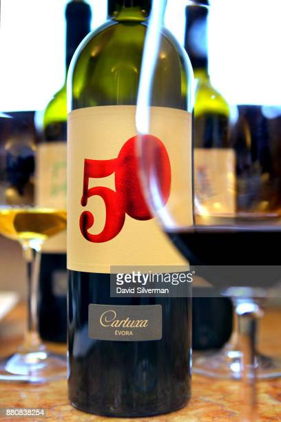 Adega da Cartuxa winery's 'DOC Alentejo Evora Tinto 2011 50 Anos' red wine is served during a tasting at the winery on September 30 2016 in the city...