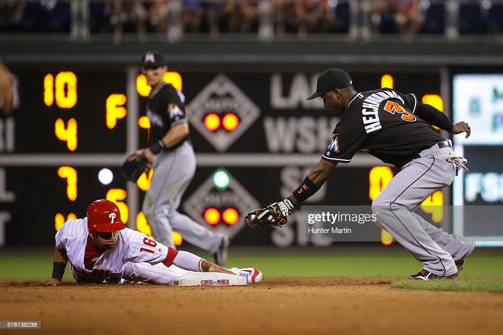 Adeiny Hechavarria #3 of the Miami Marlins attempts to tag Cesar Hernandez #16 of the Philadelphia Phillies as he slides safely into second with a stolen base in the eighth inning during a game at Citizens Bank Park on July 20, 2016 in Philadelphia, Pennsylvania. The Phillies won 4-1.