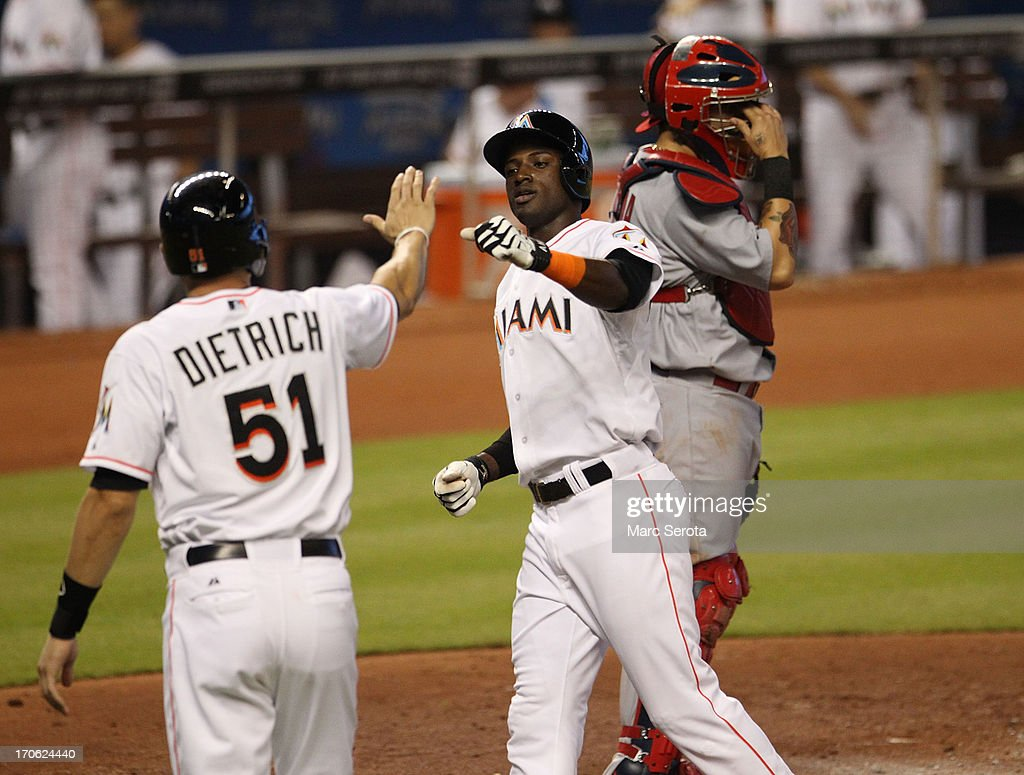 Adeiny Hechavarria #3 of the Miami Marlins celebrates scoring a run against the St. Louis Cardinals during the first inning at Marlins Park on June 15, 2013 in Miami, Florida.