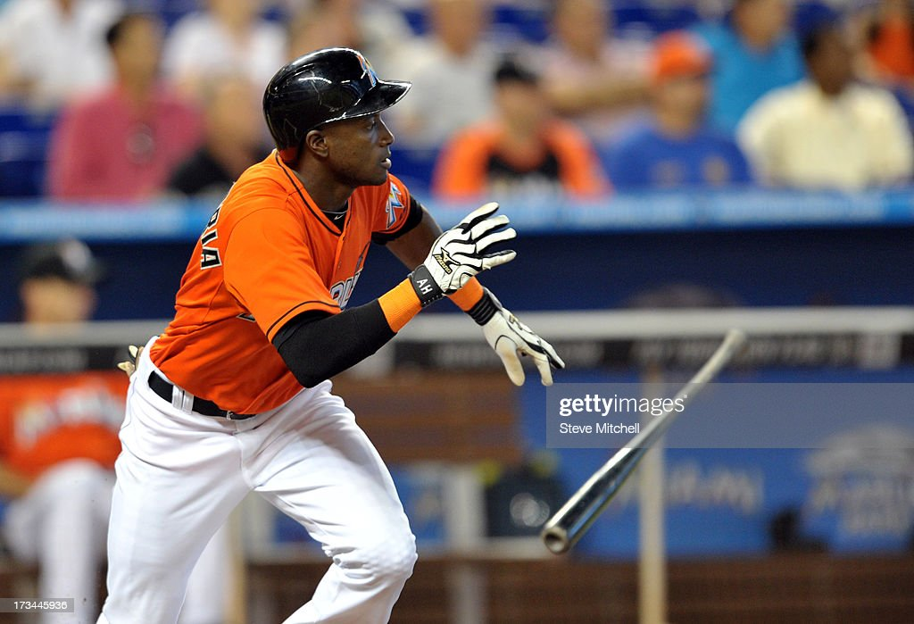 Adeiny Hechavarria #3 of the Miami Marlins connects for a base hit during the second inning against the Washington Nationals at Marlins Park on July 14, 2013 in Miami, Florida.