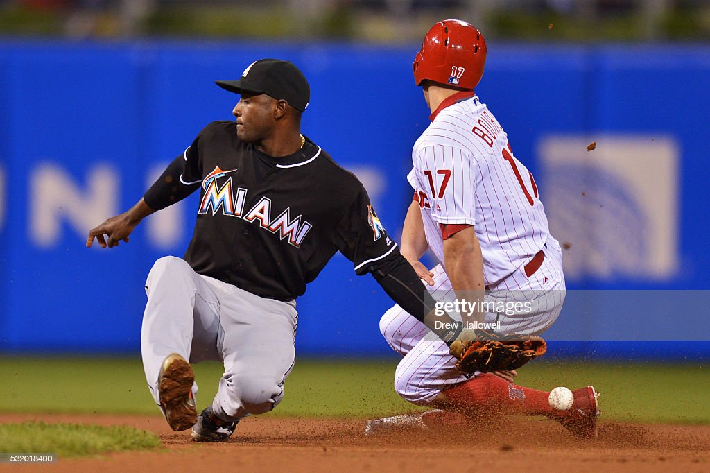 Adeiny Hechavarria #3 of the Miami Marlins is unable to hold onto the ball as Peter Bourjos #17 of the Philadelphia Phillies steals second base in the seventh inning at Citizens Bank Park on May 17, 2016 in Philadelphia, Pennsylvania. The Phillies won 3-1.